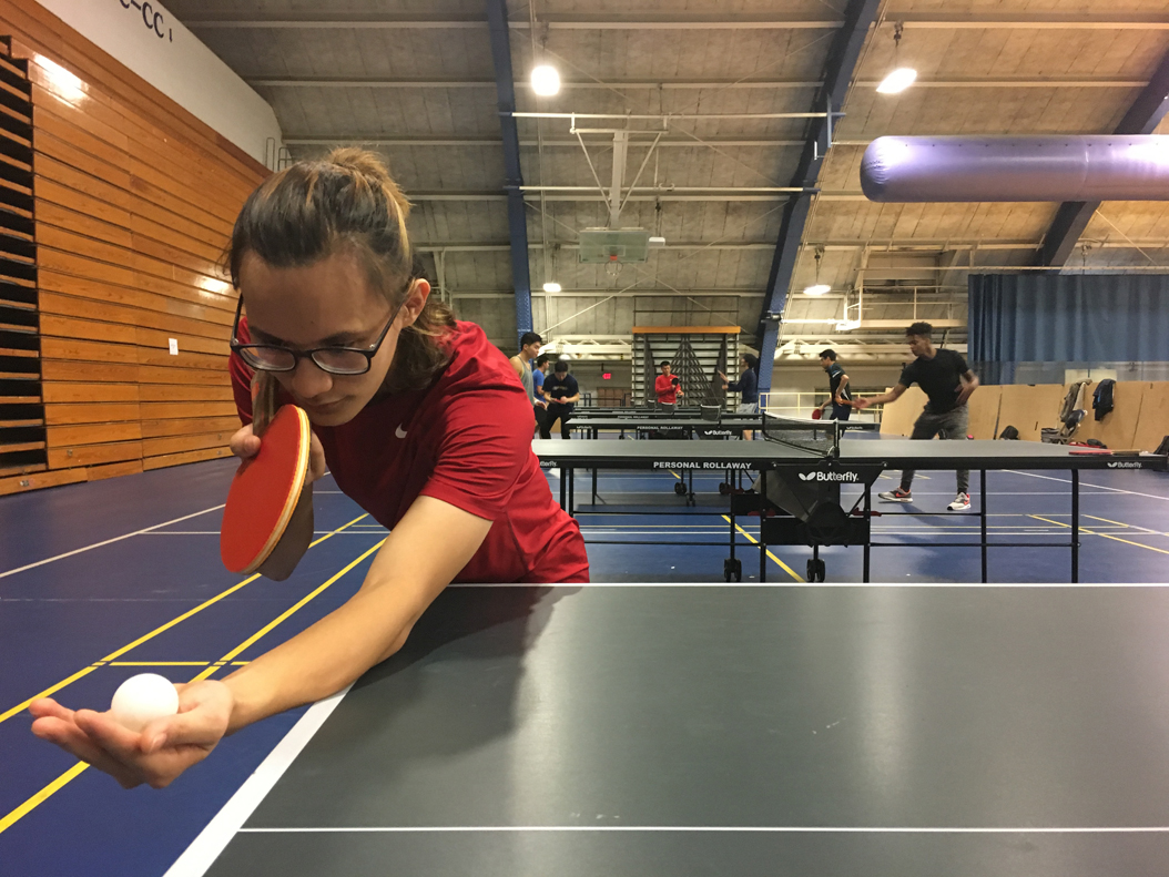 Pitt sophomore Thai Nguyen, vice president of the Pitt Ping Pong Club, lines up one of his signature curve shots. Brady Langmann | Contributing Editor