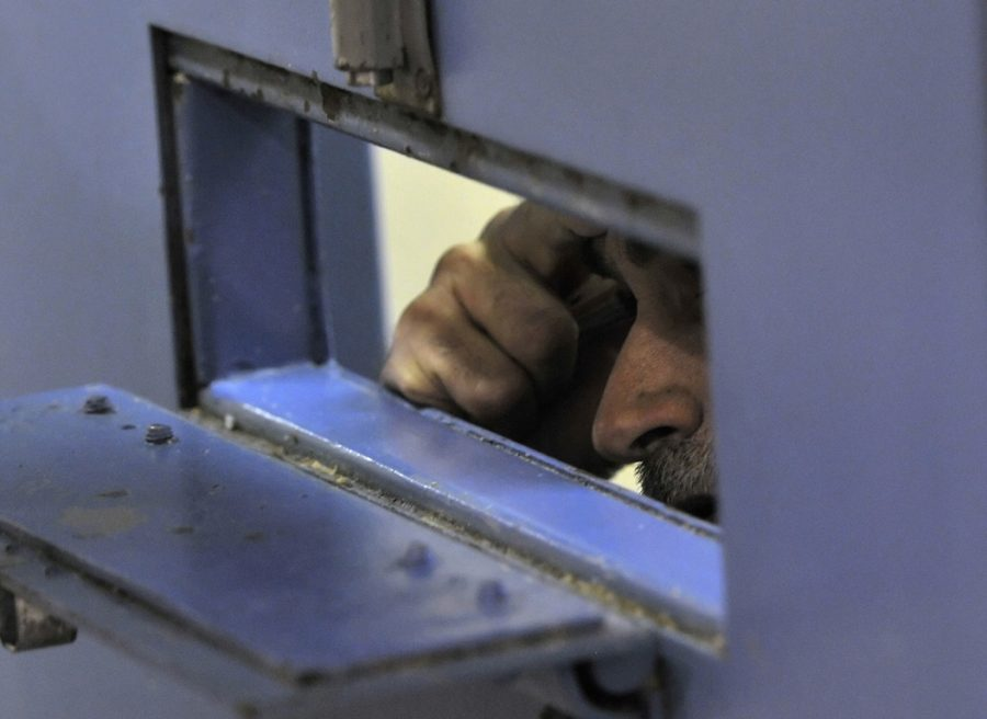 An inmate talks through the small opening in his cell door at the Sanislaus County Public Safety Center in Modesto, California, on November 18, 2010. | TNS