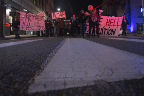 About 85 protesters marched in Oakland Thursday night against Trump and student debt. John Hamilton | Senior Staff Photographer
