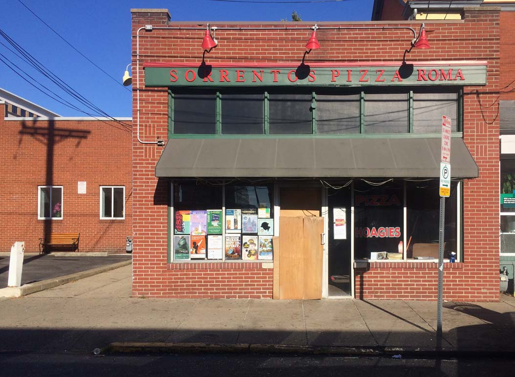 The front door of Sorrento's Pizza Roma has been boarded up since the Sunday morning incident | Lauren Rosenblatt, News Editor