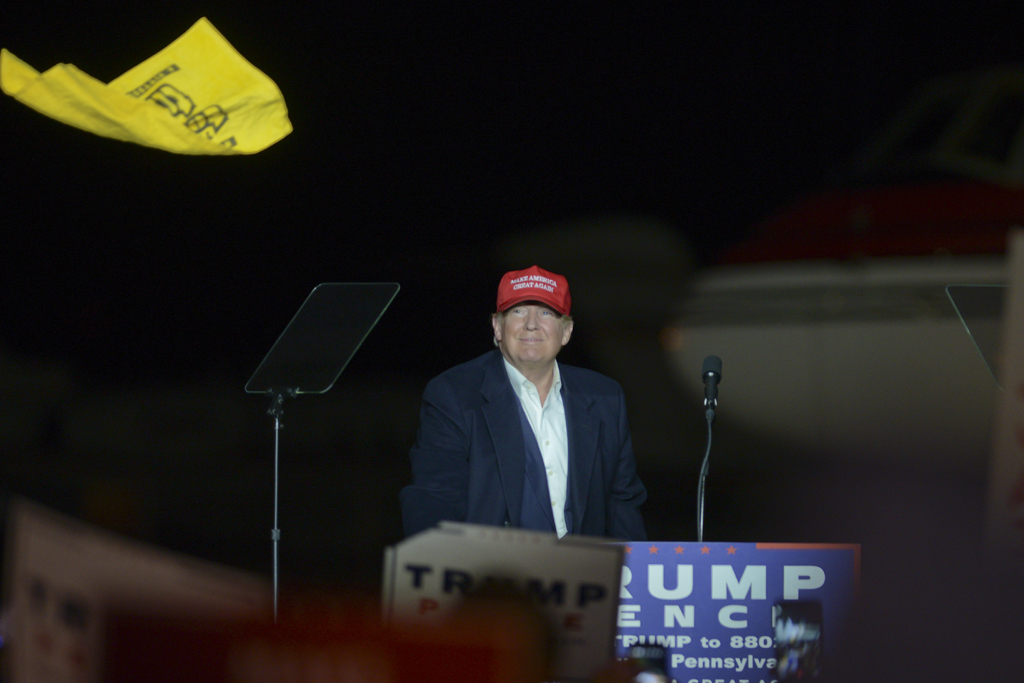 After stepping of his plane at the Atlantic Aviation Hangar at Pittsburgh International Airport, Republican presidential candidate Donald Trump waves a terrible towel and throws it into the crowd before his speech. John Hamilton | Senior Staff Photographer