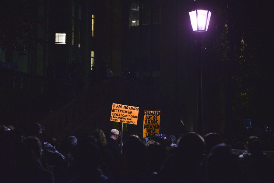 The protest, meant to promote love and tolerance and reject the presidency of Donald Trump, started outside the Cathedral of Learning, where nearly 1000 protesters gathered. Stephen Caruso | Online Visual Editor