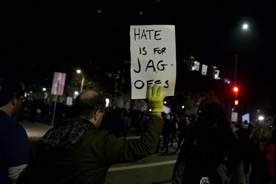 "Justin Goff, of Mt. Lebanon, participated in his first protest Wednesday night. On his sign, Goff said ""it was my wife's idea, I can't take credit."" Stephen Caruso 