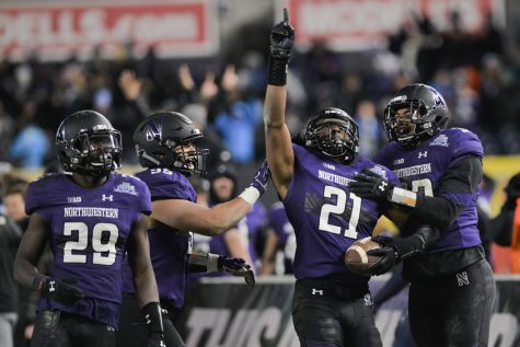 Wildcats run over Panthers for 31-24 Pinstripe Bowl victory