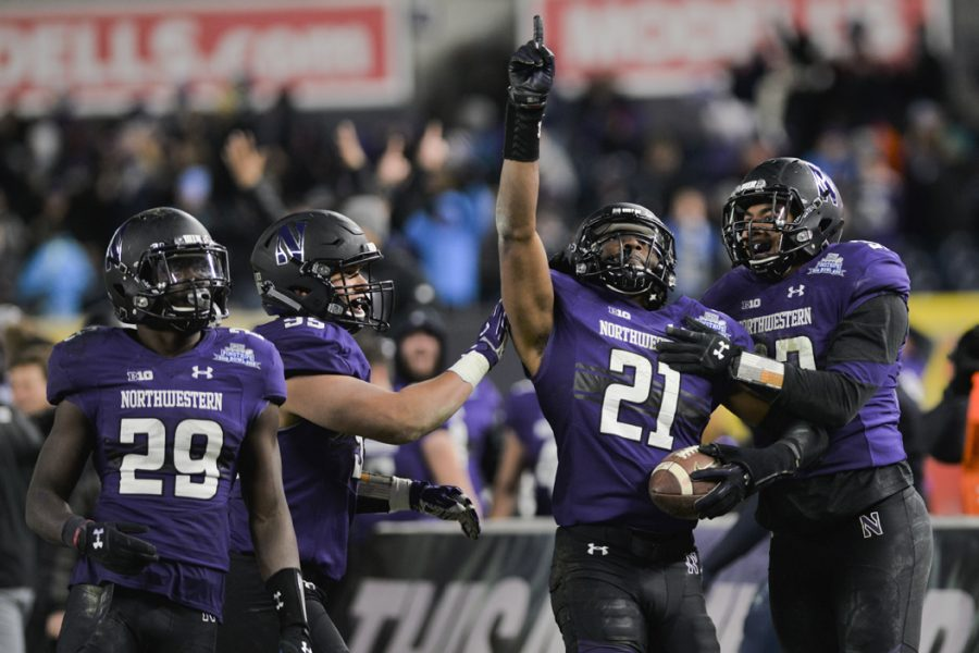 Northwestern+running+back+Justin+Jackson+%2821%29+tallied+224+yards+and+three+touchdowns+in+the+Wildcats%27+31-24+win+over+Pitt+in+the+Pinstripe+Bowl.+Elaina+Zachos+%7C+Senior+Staff+Photographer