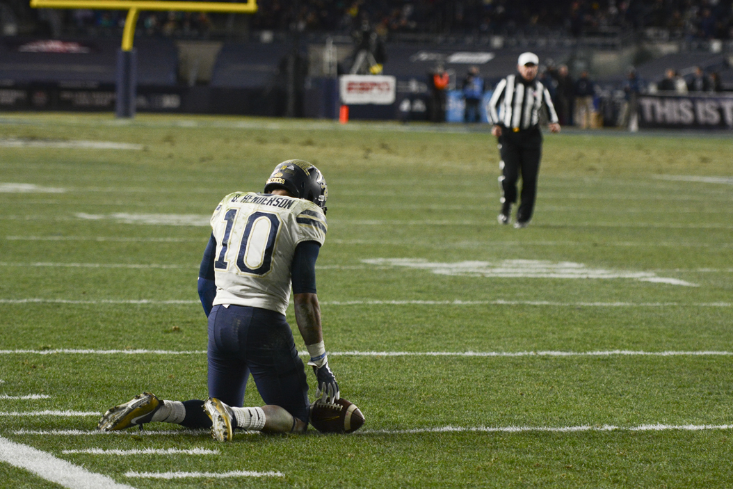 Quadree Henderson kneels on the Yankee Stadium field during the 2016 New Era Pinstripe Bowl — Pitt's last bowl game appearance, which ended in a 31-24 loss to Northwestern.