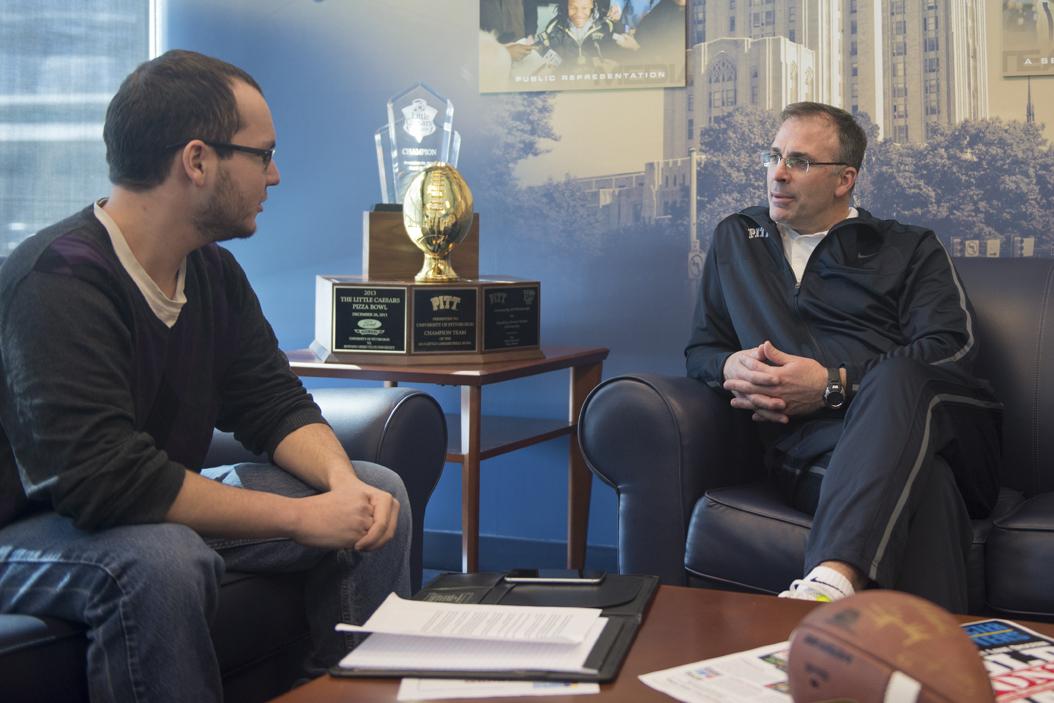 Dan Sostek chats with Pitt football head coach Pat Narduzzi. Jeff Ahearn | Senior Staff Photographer