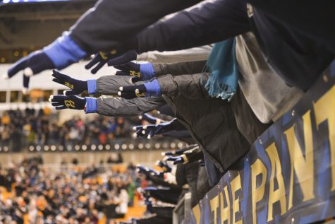 Pitt fans reaching out during the singing of