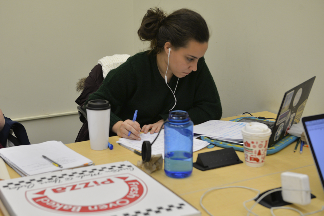 Camilla Cook, a senior in environmental studies, ordered a pizza while studying in the Hillman Library Sunday. Kyleen Considine | Staff Photographer