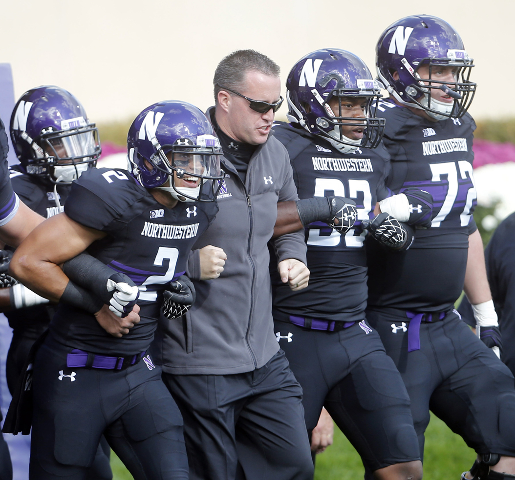 Northwestern head coach Pat Fitzgerald has returned the Wildcats to prominence after leading them to two Big Ten titles as a player in 1995 and 1996. (TNS)