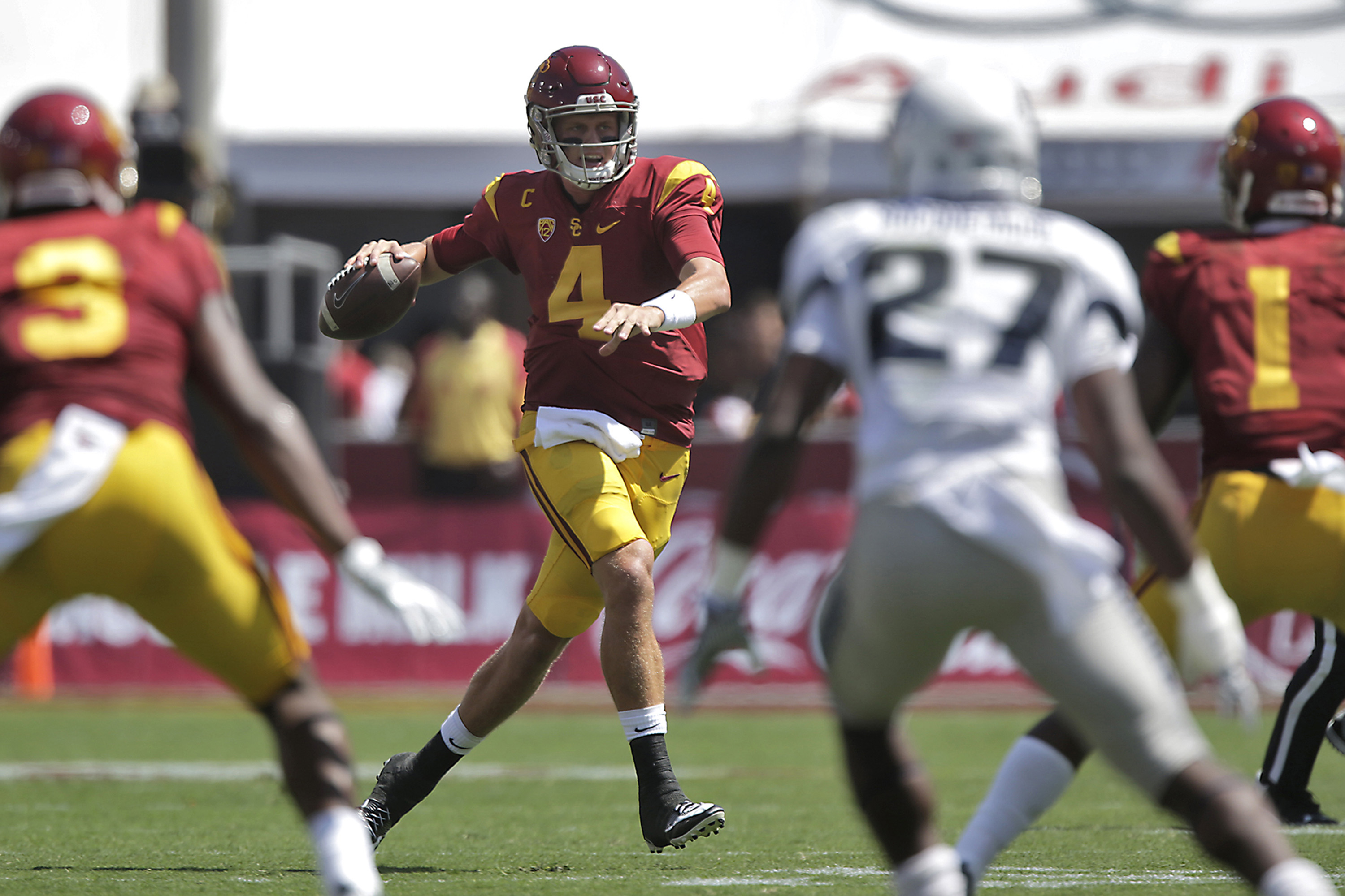 Former USC quarterback Max Browne (4) throws on the run during first-half action against Utah State at the Los Angeles Coliseum on Saturday, Sept. 10, 2016, in Los Angeles. USC won, 45-7. (Robert Gauthier/Los Angeles Times/TNS)