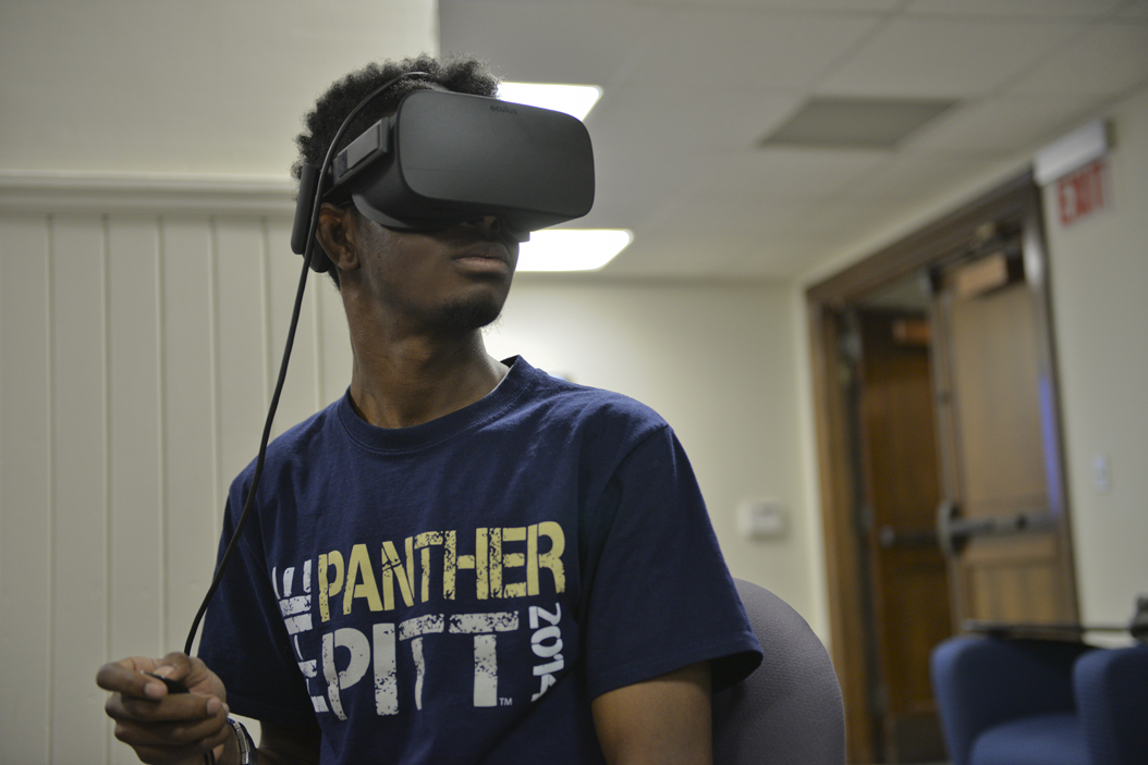 Shawn Jackson, a senior computer science major, works as a student employee at the Teaching Center. For his first VR experience, he used Star Chart, a constellation simulation. Elaina Zachos | Visual Editor