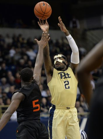 Pitt senior Michael Young finished with just two points on 0-for-10 shooting against Miami while wearing a protective mask for a broken orbital bone. Jeff Ahearn | Senior Staff Photographer