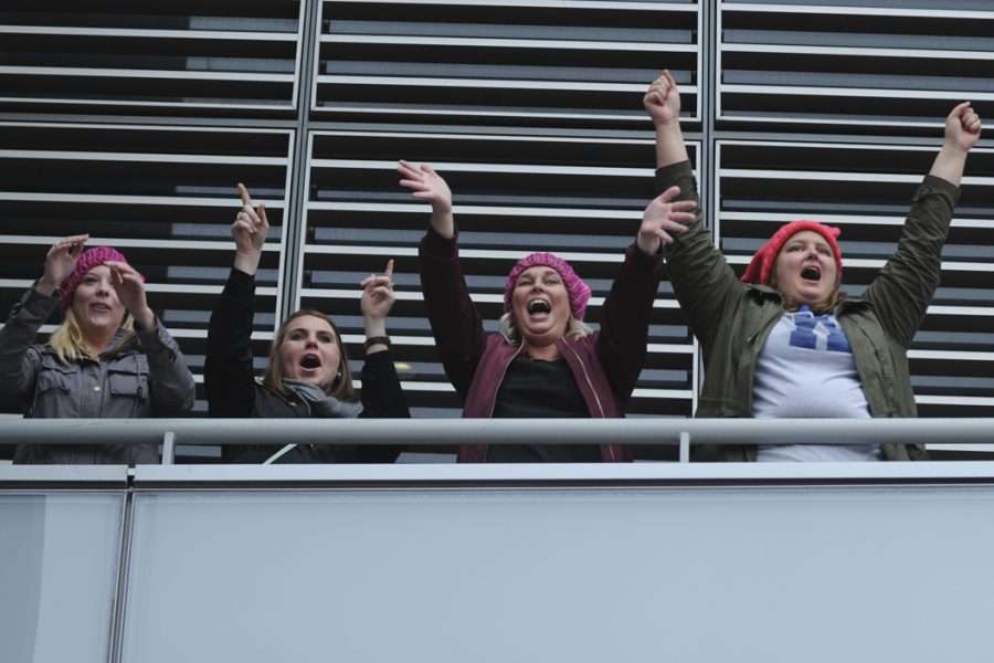 Also watching from Newseum, several women cheer as the marchers go by. John Hamilton | Visual Editor