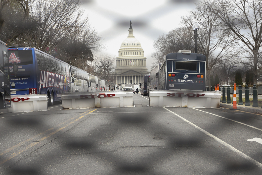 The Capitol Building is seen through a fence. John Hamilton | Visual Editor