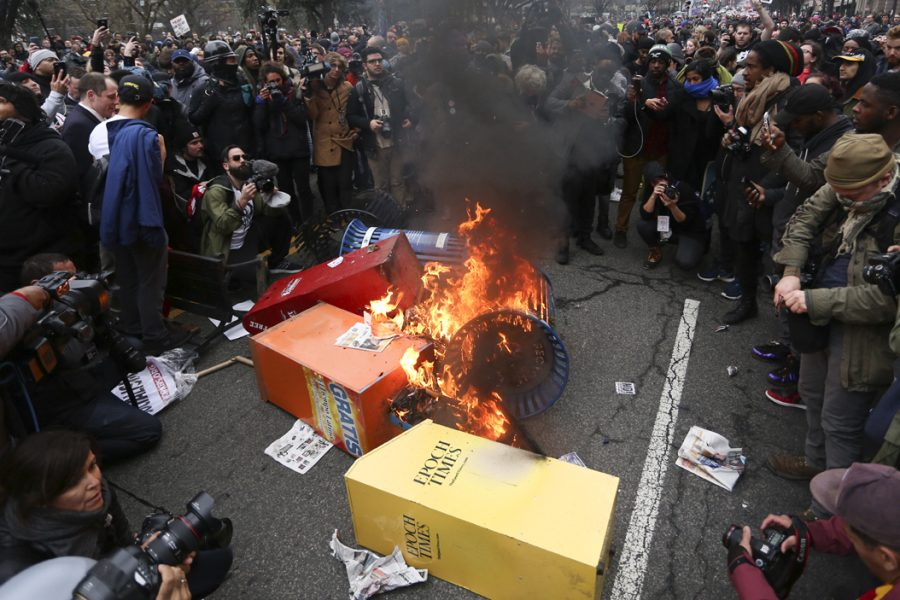 Protesters burn news stands on K street.