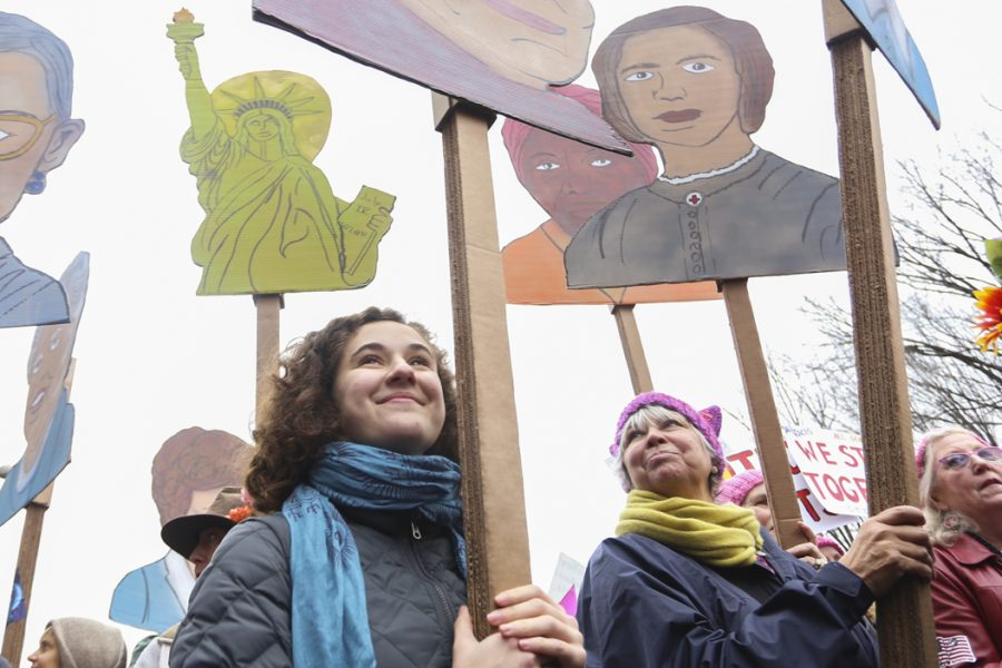 A group of marchers from rural Pennsylvannia carries signs with the faces of famous suffragettes. John Hamilton | Visual Editor