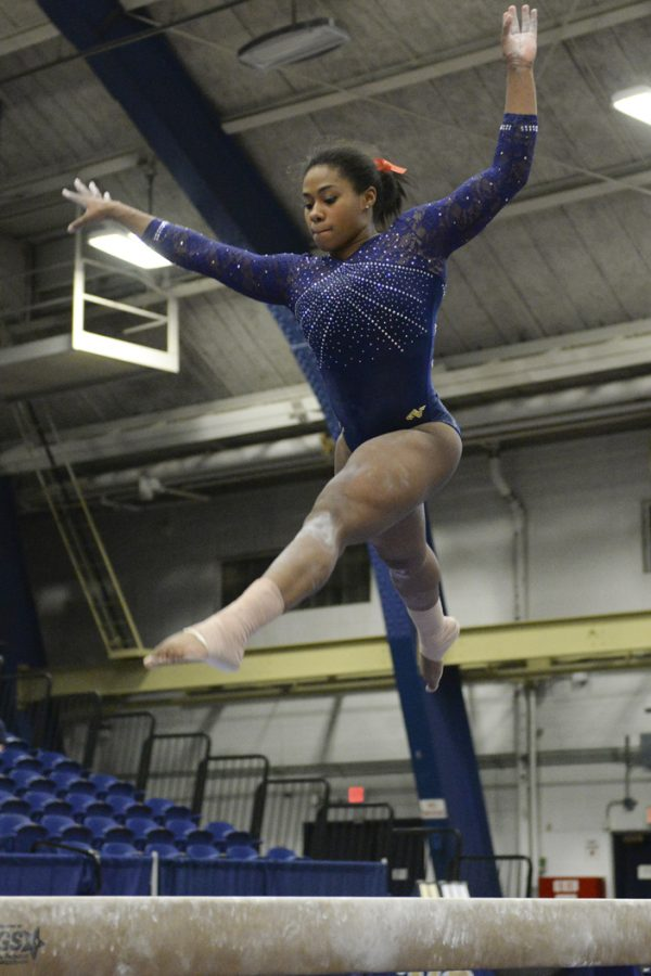 Tracey Pearson competes against West Virginia on the beam. Pitt won the meet against the 21st ranked mountaineers. Jeff Ahearn|Senior Staff Photographer