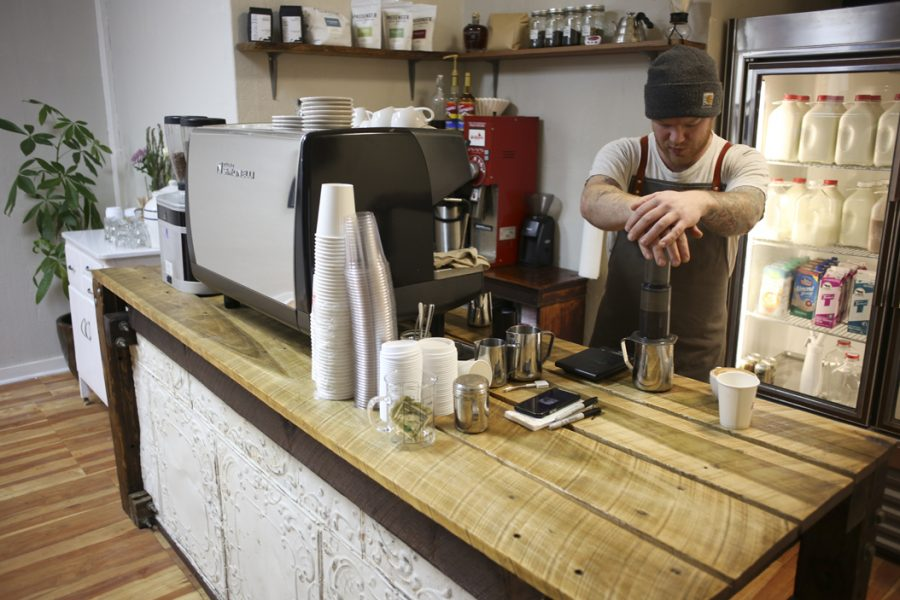 Redhawk Coffee owner Braden Walter brews a coffee using an Aeropress. John Hamilton | Visual Editor