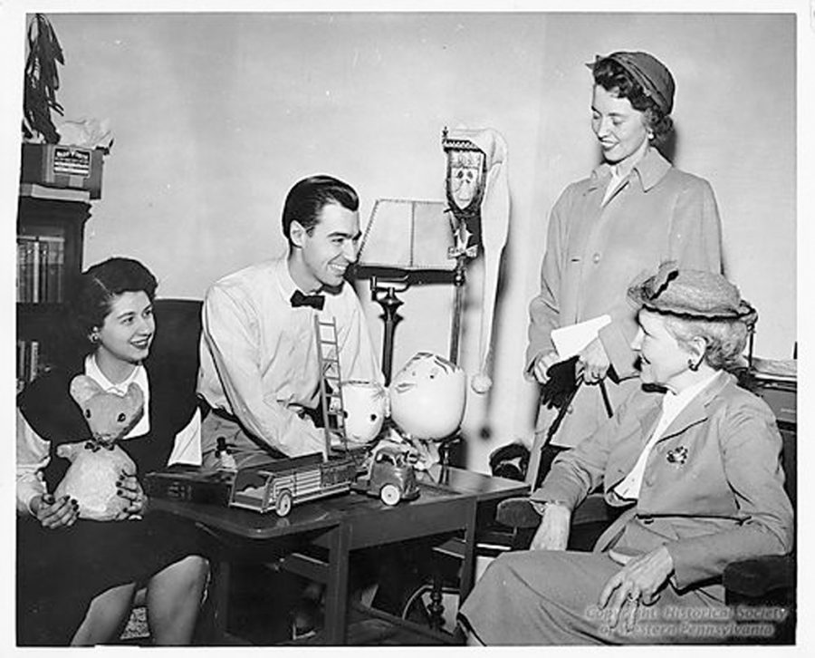 Josie Carey and Fred Rogers, staff members at WQED, Pittsburgh's educational television station, explain the makings of a children's show to station visitors Mrs. W.J. Bass (seated) and Mrs. W.C. Richardson. Courtesy Detre Library and Archives Division, Heinz History Center
