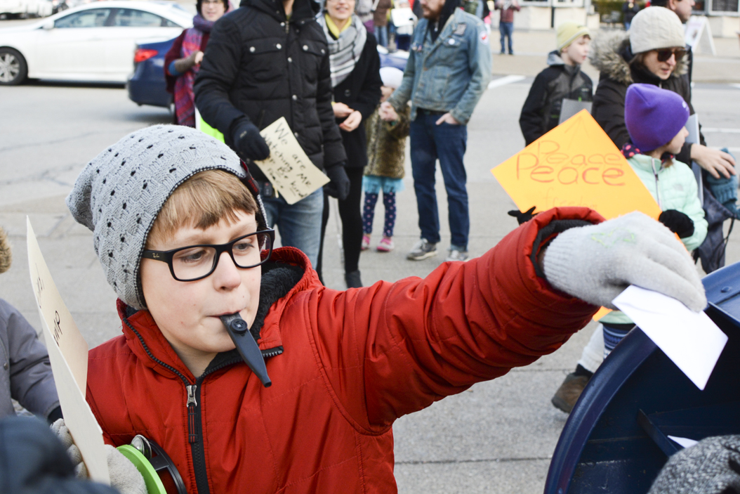 Henry Wagler, 9, puts a letter to President-elect Donald Trump into a mailbox at the corner of Forbes and Bigelow during the Pittsburgh Children's March for Peace and Kindess Sunday in Schenley Plaza. Stephen Caruso | Online Visual Editor