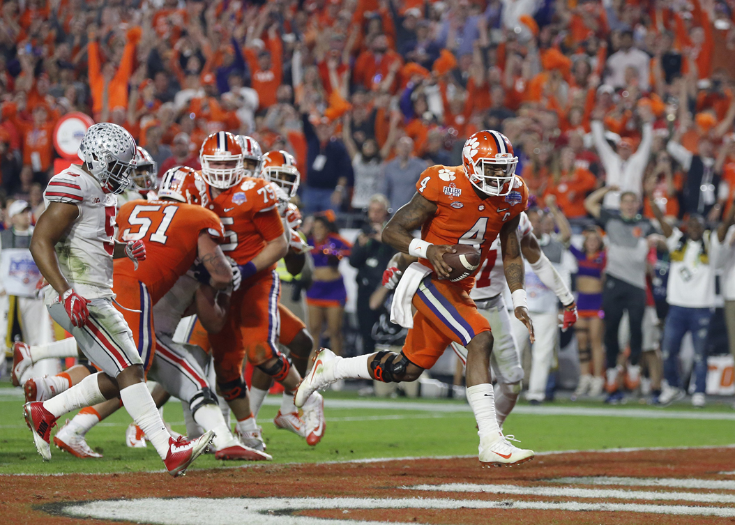Clemson quarterback Deshaun Watson (4) runs for a touchdown in the Tigers' 31-0 national semifinal victory against Ohio State. Adam Cairns/Columbus Dispatch/TNS