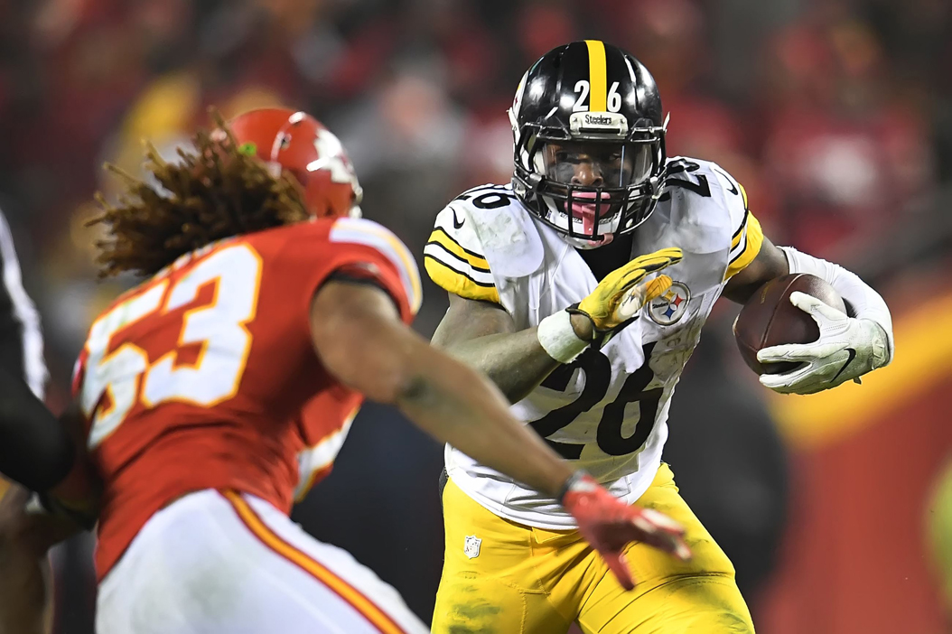 Le'Veon Bell rushes against the Kansas City Chiefs during the AFC Divisional Playoff game on Sunday. Peter Diana/Pittsburgh Post-Gazette/TNS