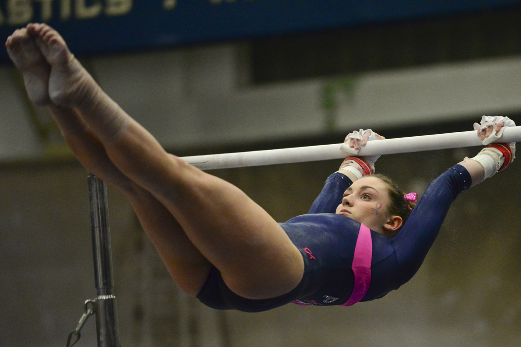 Sophomore Lucy Brett scored a 9.8 on the uneven bars Friday night in a loss to UNC. Anna Bongardino | Staff Photographer