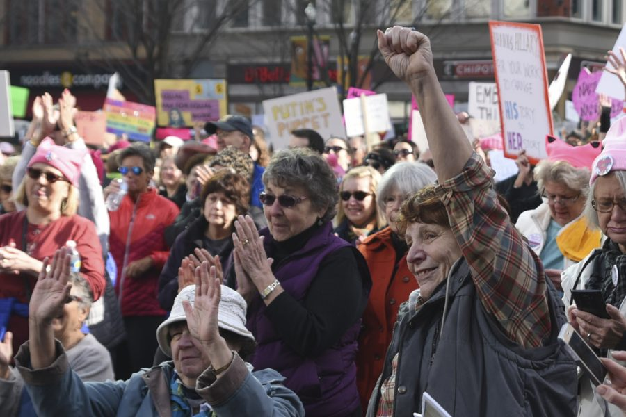 Women+watch+speakers+at+the+Women%27s+March+in+downtown+Pittsburgh.+Over+20%2C000+were+in+attendence.+Matt+Hawley+%7C+Staff+Photographer