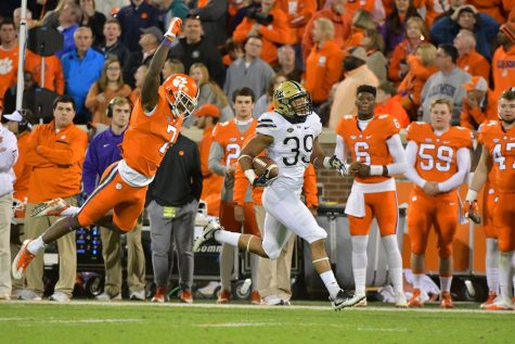 First-year linebacker Saleem Brightwell returns an interception 70 yards in the fourth quarter of the Panthers' 43-42 win against Clemson. Mike Williams (7) made a shoestring tackle to prevent a touchdown. Courtesy of Pete Madia/Pitt Athletics