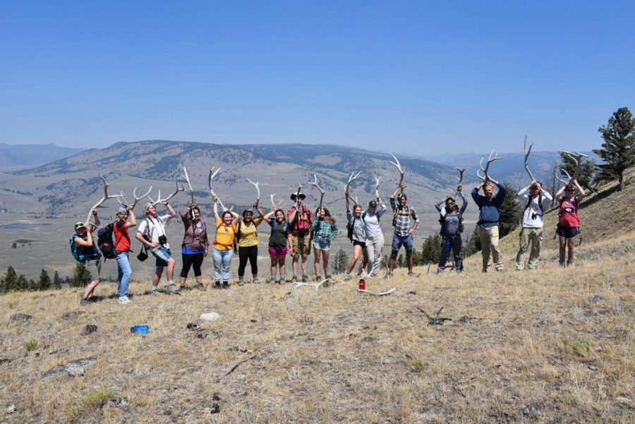 Students pose for a photograph on Pitt's property near Laramie, Wyoming. Courtesy of UHC