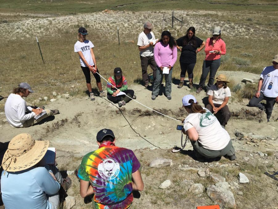 Students complete field work at the dinosaud bone quarryon Pitt's property in Wyoming. Courtesy of UHC