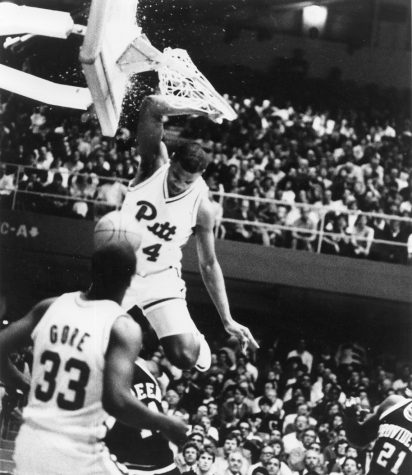 Jerome Lane shatters the backboard at the Fitzgerald Field House with one of college basketball's most memorable slam dunks. Courtesy of Pitt Athletics