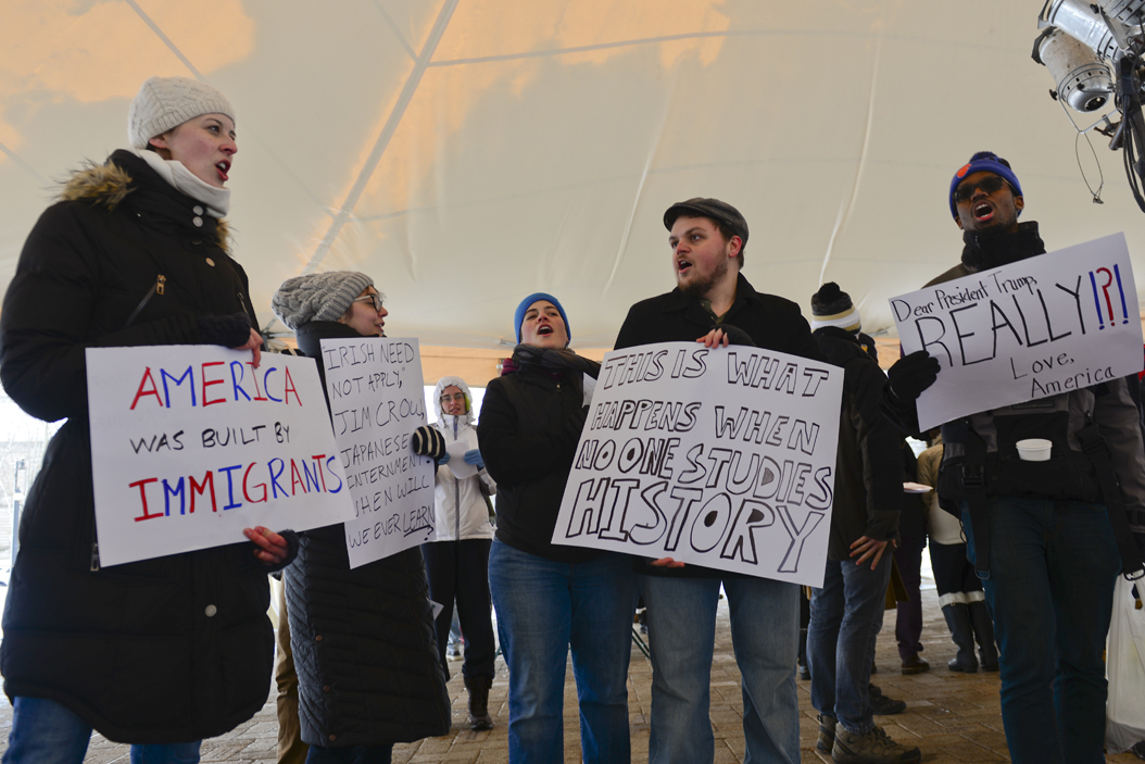Pittsburghers braved the cold to attend the Academics United demonstration to show support for citizens affected by President Trump's immigration ban. Elaina Zachos | Senior Staff Photographer