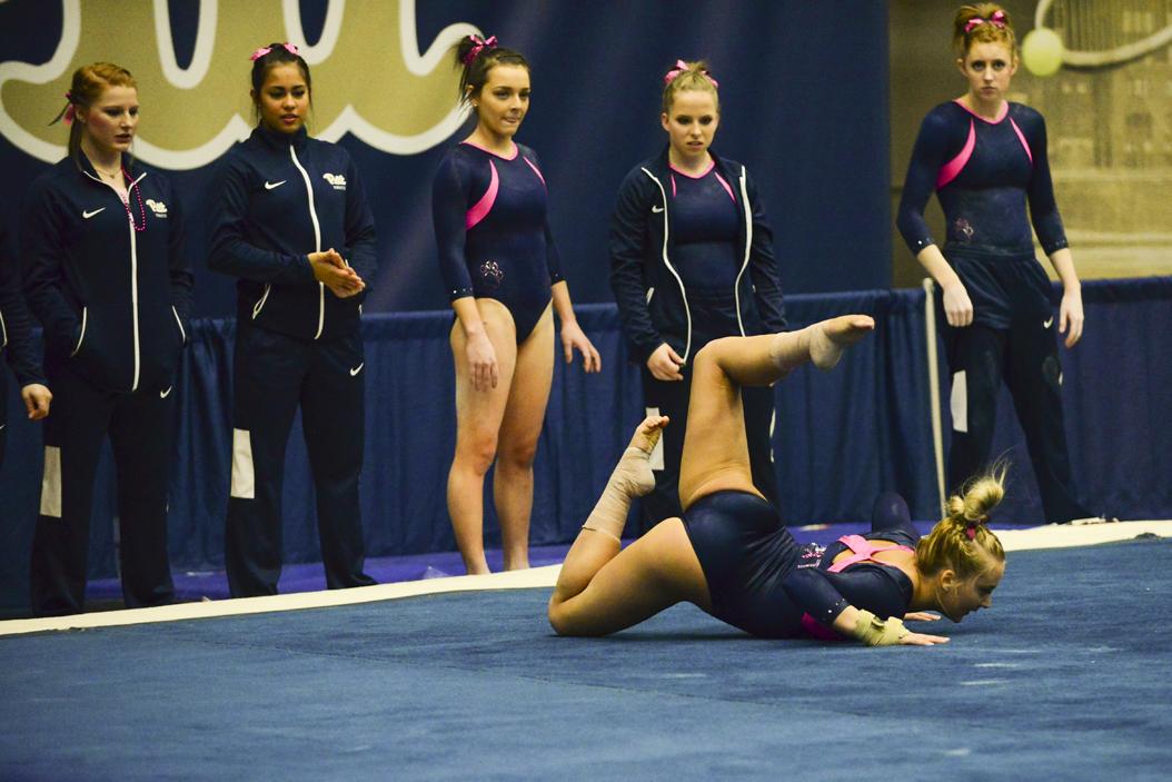 Pitt gymnastics watch as their teammates compete in the floor exercise on Jan 28. Anna Bongardino   Staff Photographer
