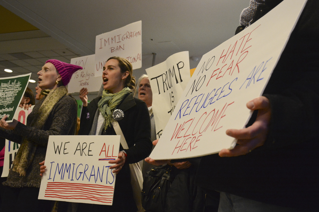 People gather at Pittsburgh International Airport to protest President Trump's executive order restricting immigrants from seven majority muslim nations from coming to the United States for 90 days. Stephen Caruso | Online Visual Editor