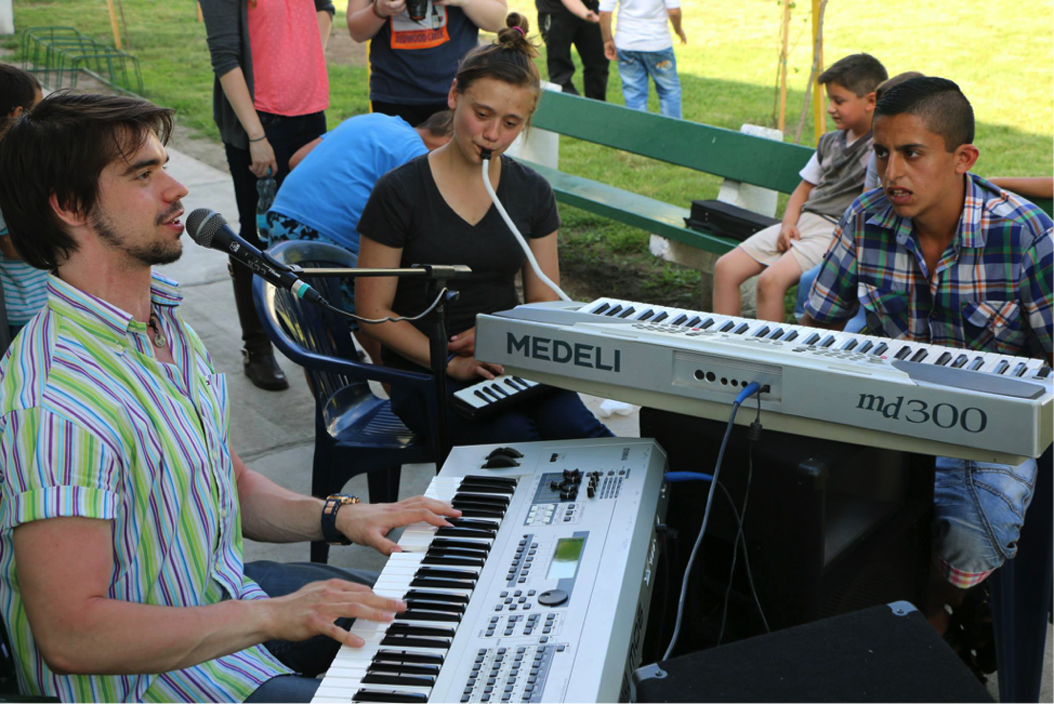 Kelly Glavin plays a melodica in an impromptu music session with Czech keyboardists |Courtesy of Kelly Glavin
