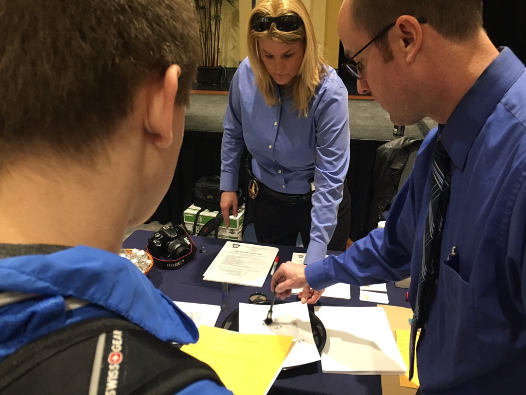 Demonstration on fingerprinting. Courtesy of DaVaughn Vincent-Bryan, Assistant Director for Residential Programming