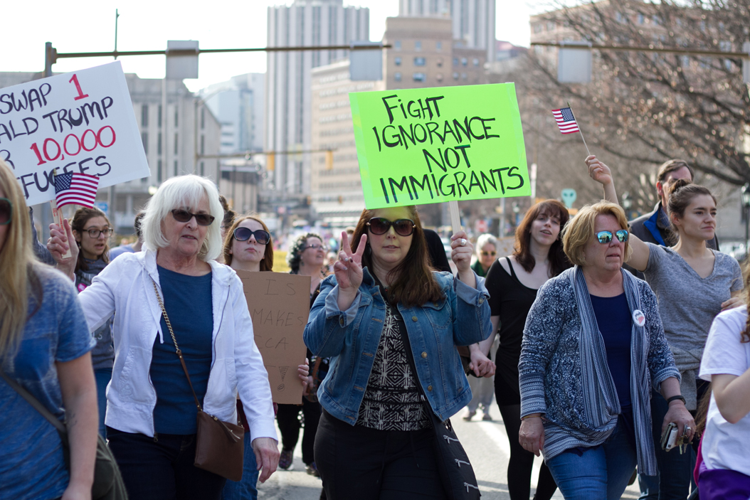 Trump protesters marched down Forbes Avenue on Saturday as part of a Pitt College Democrats rally.  Thomas Yang   Staff Photographer