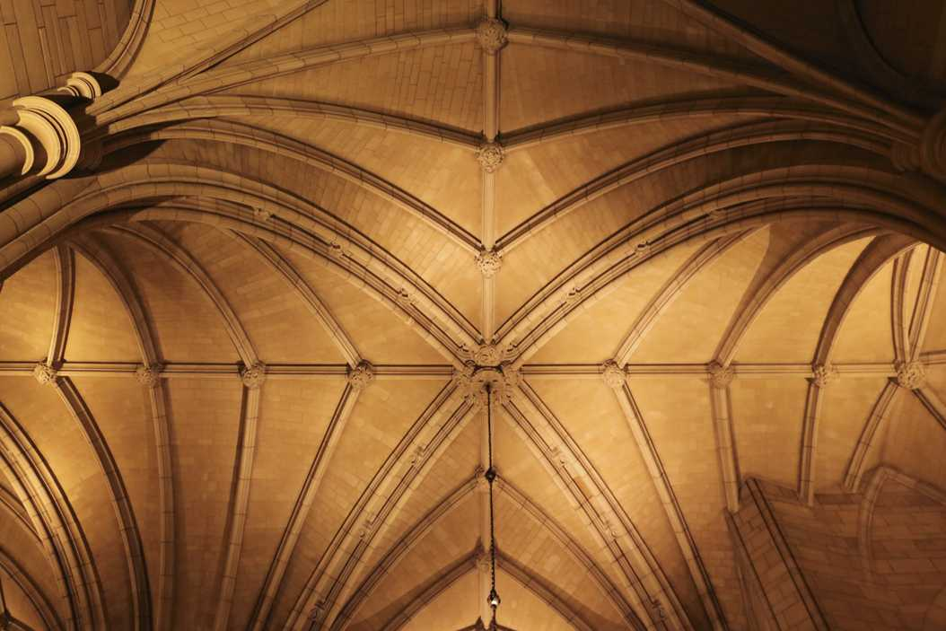 Warm lighting illuminates the ceiling of the Cathedral of Learning. John Hamilton | Visual Editor