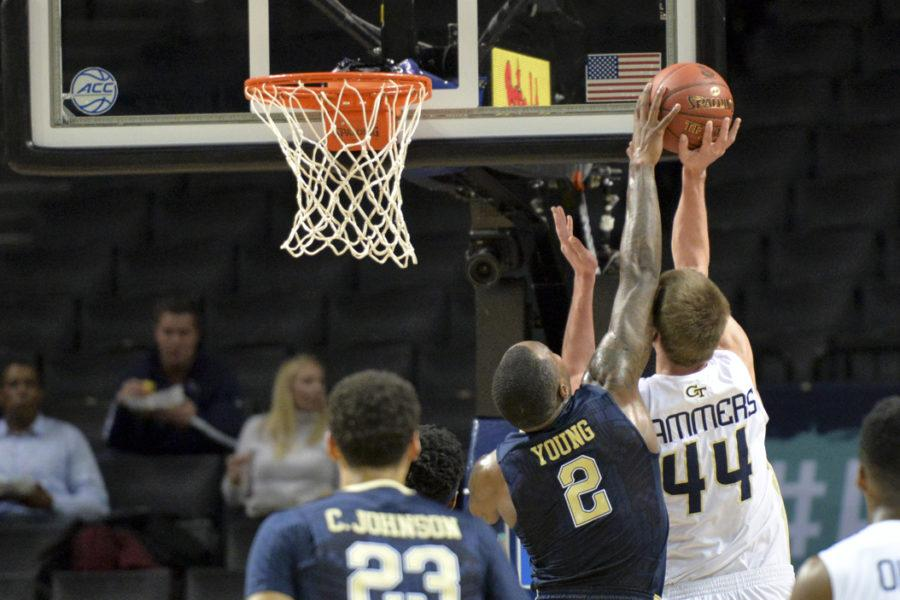 Pitt senior forward Michael Young (2) makes an emphatic block on Georgia Tech center Ben Lammers in the first half of the Panthers' 61-59 win. John Hamilton | Visual Editor