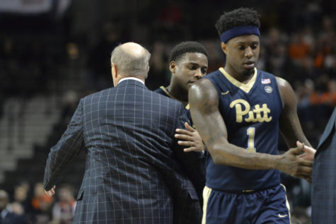 Pitt head coach Kevin Stallings consoles seniors Jamel Artis and Chris Jones after taking them out of what may have been the final game of their college careers, a 75-63 loss vs. No. 21 Virginia in the second round of the ACC Tournament. John Hamilton | Visual Editor