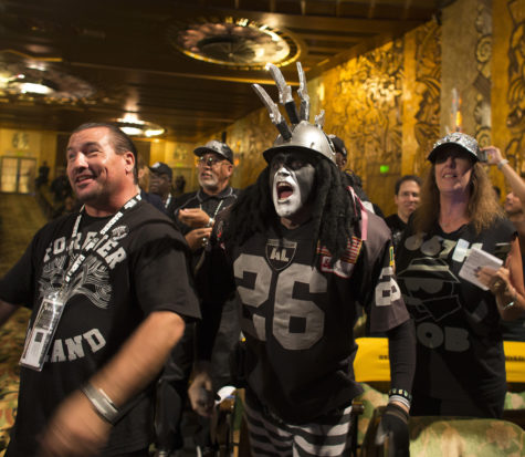 Oakland Raider fan Ray Perez, middle, cheers with other fans as Raiders owner Mark Davis speaks during a town hall meeting with NFL executives at the Paramount Theatre in Oakland, Calif., on October 29, 2015. (Gina Ferazzi/Los Angeles Times/TNS)