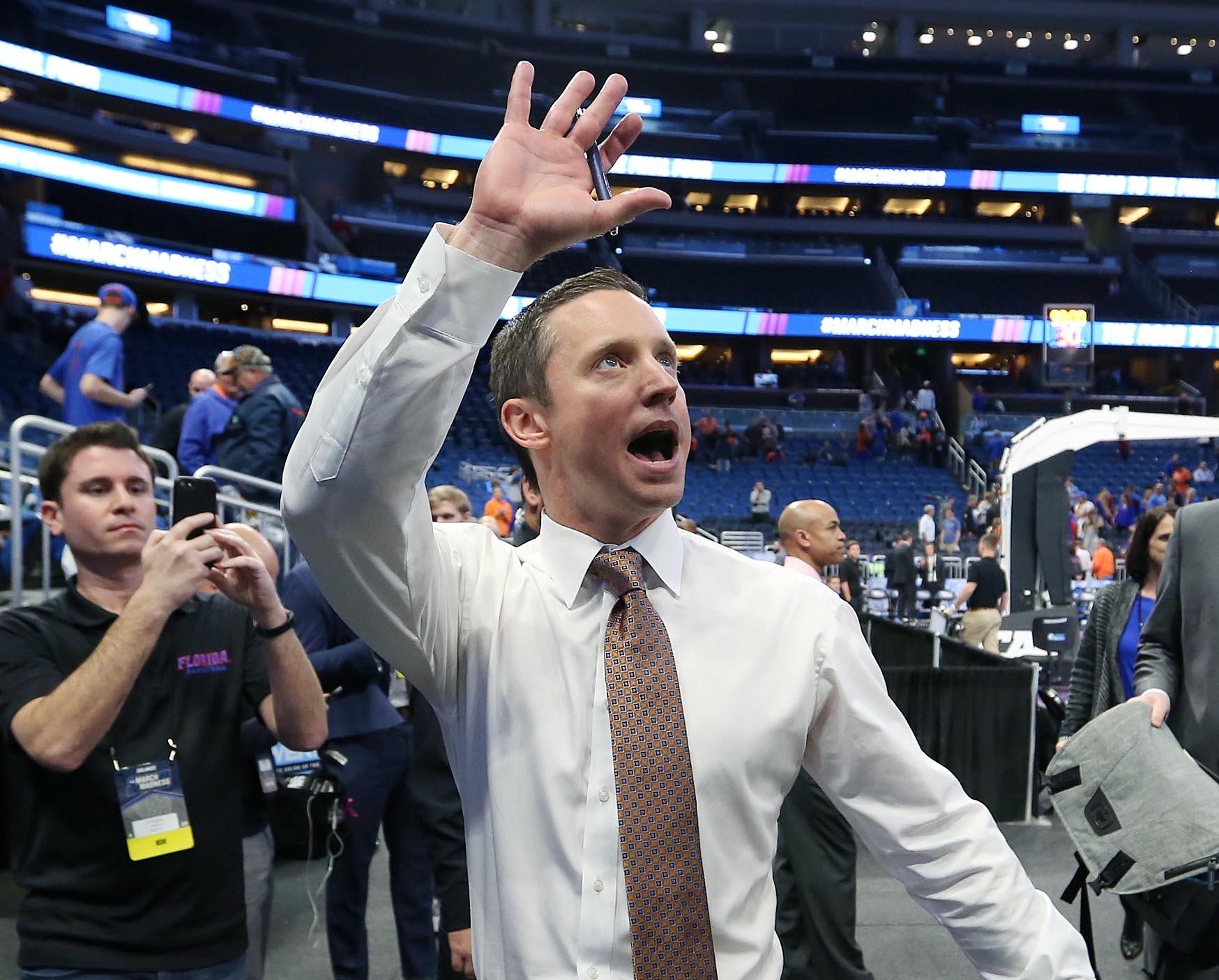 Florida head coach Mike White cheers as he leaves the court after an 80-65 win against East Tennessee State in the first round of the NCAA Tournament on Thursday, March 16, 2017, at the Amway Center in Orlando, Fla. (Stephen M. Dowell/Orlando Sentinel/TNS)