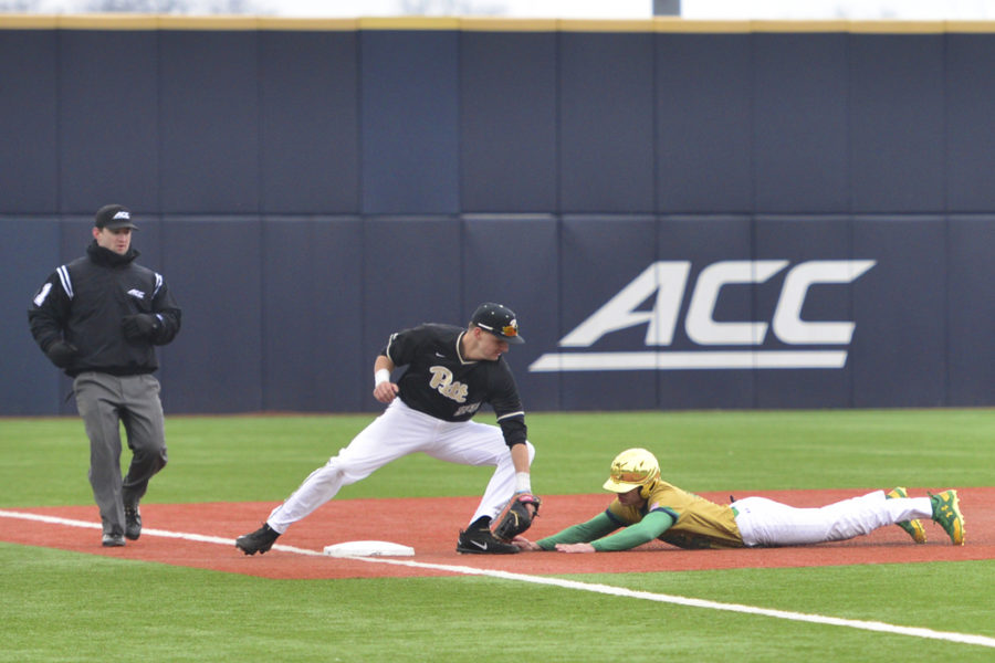 Third baseman Nick Banman tags out a Notre Dame runner during three game weekend series against the Fighting Irish. Anna Bongardino | Staff Photographer