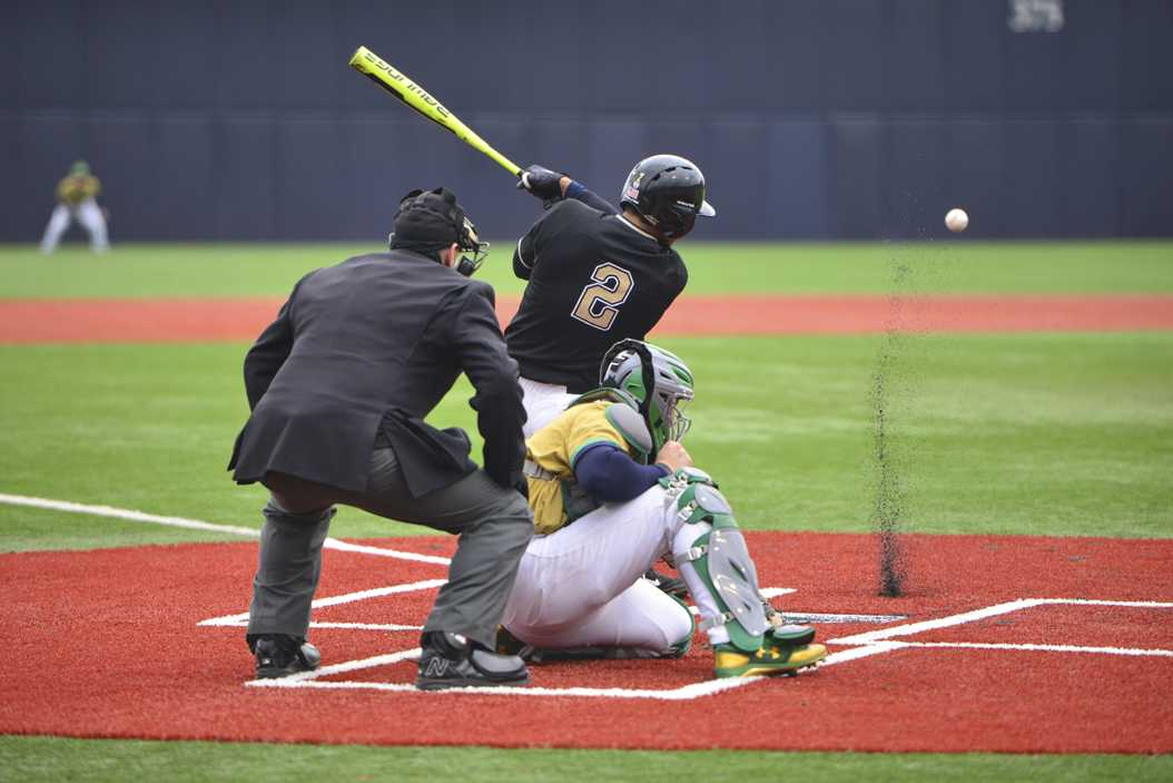 Senior shortstop P.J. DeMeo puts the ball in play against Notre Dame last weekend. Anna Bongardino | Staff Photographer