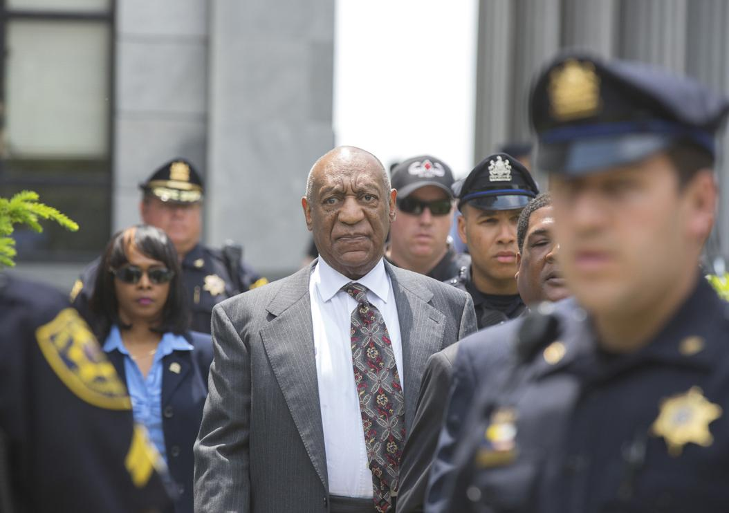 Bill Cosby is escorted from the courthouse after attending his preliminary hearing at the Montgomery County Courthouse on May 24, 2016 in Norristown, Pa. The judge ruled there is sufficient evidence for the sex abuse case against the comedian to proceed to trial.  (Ed Hille/Philadelphia Inquirer/TNS)