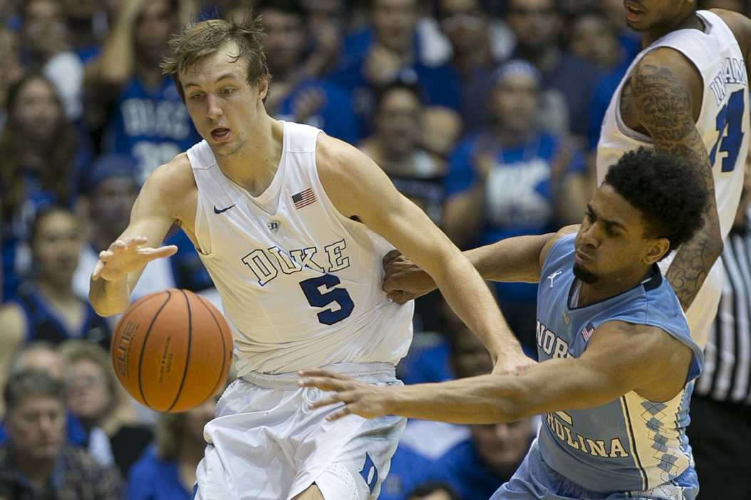 Duke's Luke Kennard (5) has the ball stolen by North Carolina's Joel Berry II, right, in the second half at Cameron Indoor Stadium in Durham, N.C., on Saturday, March 5, 2016. UNC won, 76-72. (Robert Willett/Raleigh News & Observer/TNS)