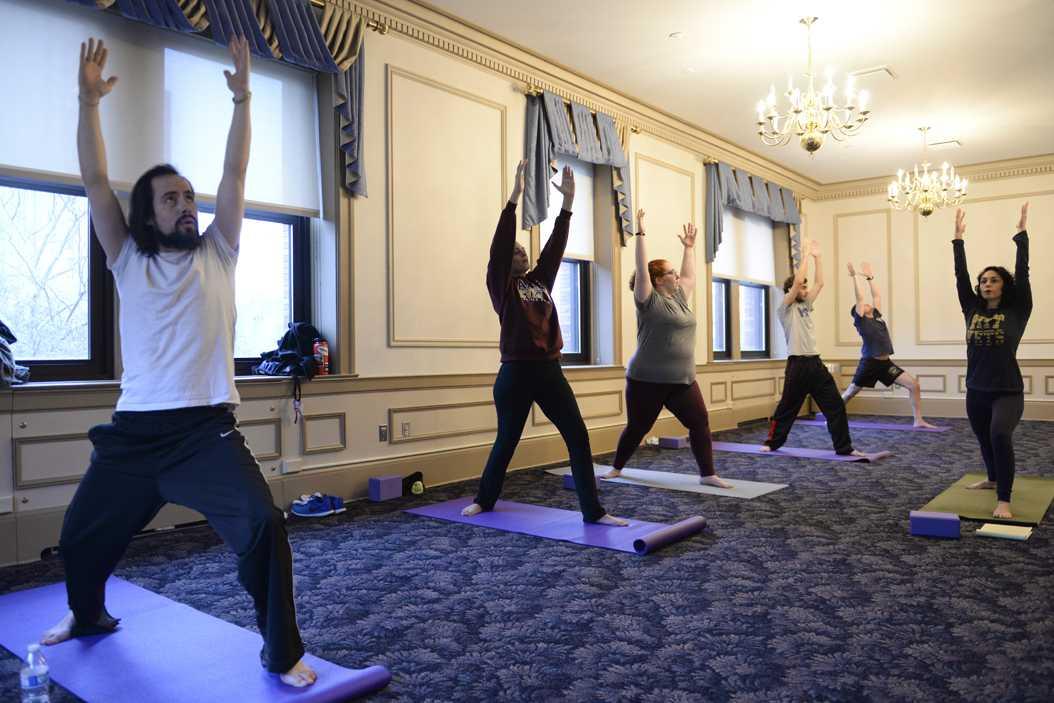 Pitt Vets holds a yoga session in the William Pitt Union on Monday. John Hamilton | Visual Editor