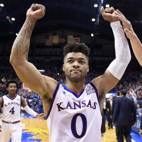Kansas point guard Frank Mason (0) celebrates with teammate Mitch Lightfoot, right, after a 73-68 win against Baylor on Wednesday, Feb. 1, 2017, at Allen Fieldhouse in Lawrence, Kansas. (Rich Sugg/Kansas City Star/TNS)